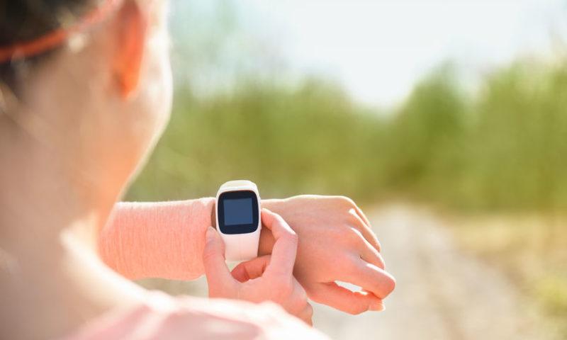 woman-jogging-wearing-fitness-tracker